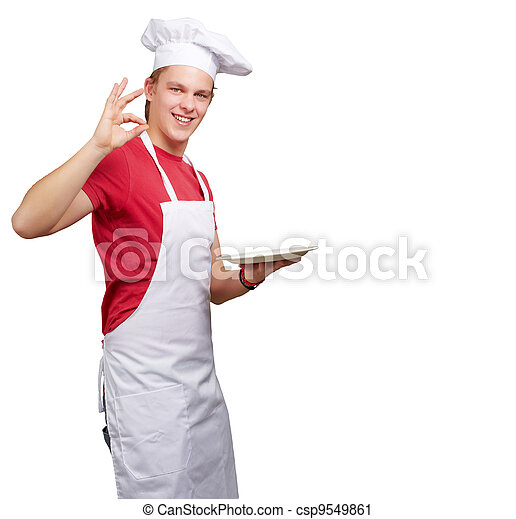 portrait of young cook man against a white background - csp9549861