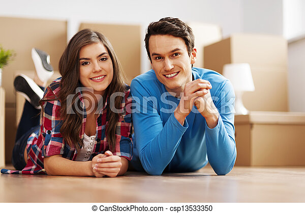 Portrait of young couple in their new home - csp13533350