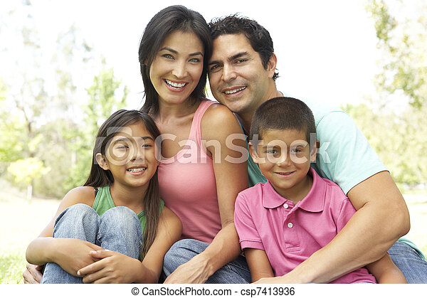 Portrait Of Young Family In Park - csp7413936