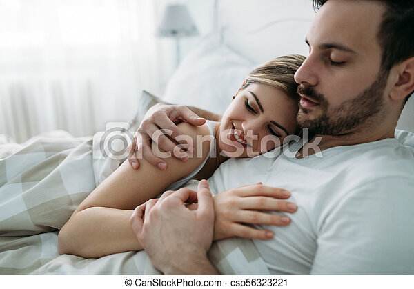 Portrait of young loving couple in bedroom - csp56323221