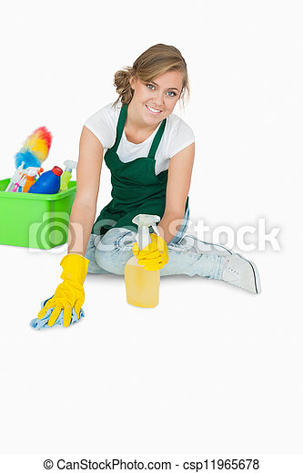 Portrait of young maid cleaning floor - csp11965678