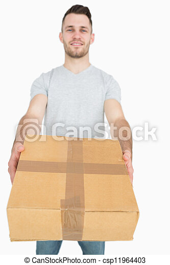 Portrait of young man giving you a package box - csp11964403