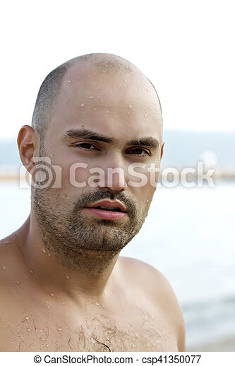 Portrait of young man on beach - csp41350077