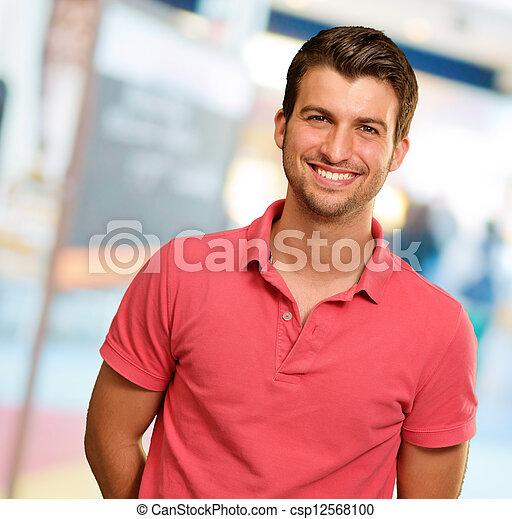 Portrait of young man smiling - csp12568100