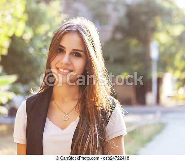 Portrait of young smiling teen girl - csp24722418