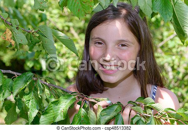Portrait of young smiling teen girl, outdoor - csp48513382