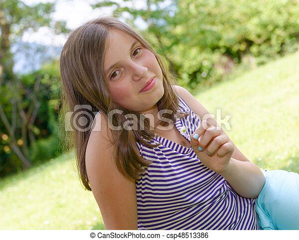 Portrait of young smiling teen girl, outdoor - csp48513386