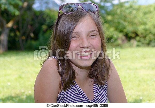 Portrait of young smiling teen girl, outdoor - csp48513389