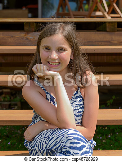 Portrait of young smiling teen girl, outdoor - csp48728929