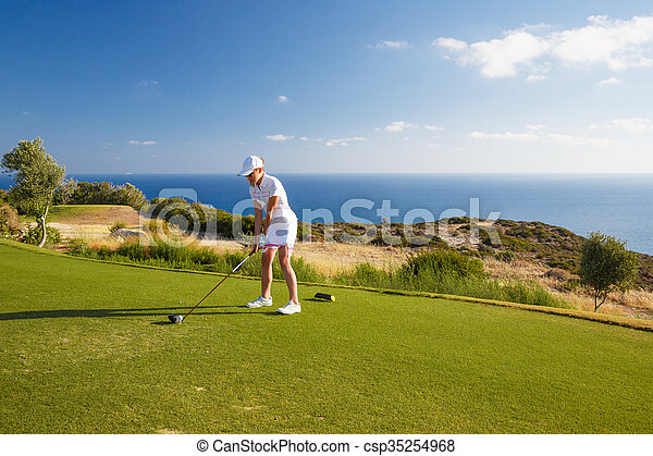 portrait of young woman golfer - csp35254968