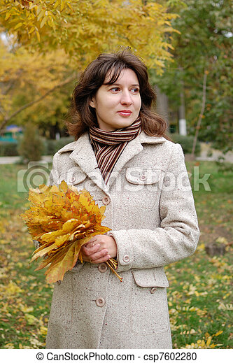 Portrait of young woman in autumn park - csp7602280