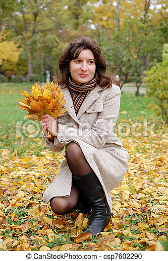 Portrait of young woman in autumn park - csp7602290