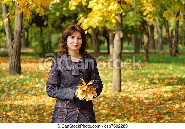 Portrait of young woman in autumn park - csp7602283