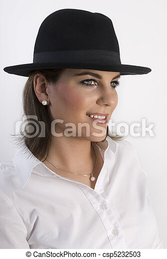 Portrait of young woman in black hat. - csp5232503