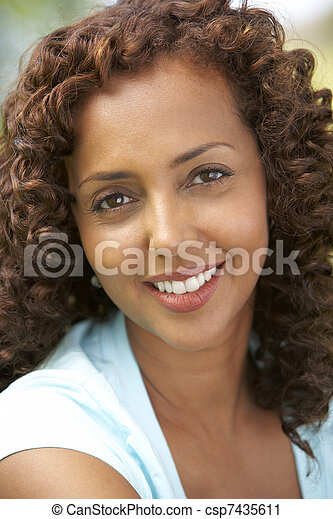 Portrait Of Young Woman In Park - csp7435611