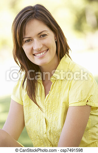 Portrait Of Young Woman In Park - csp7491598
