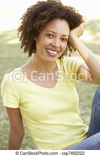 Portrait Of Young Woman In Park - csp7492222