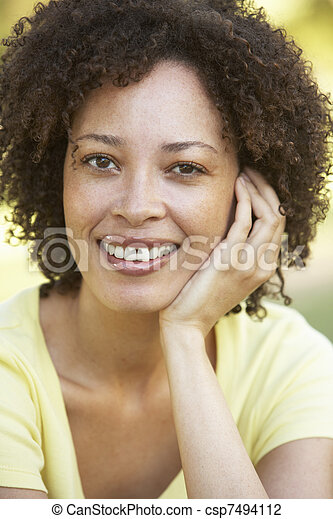 Portrait Of Young Woman In Park - csp7494112