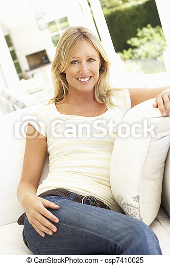 Portrait Of Young Woman Relaxing On Sofa - csp7410025