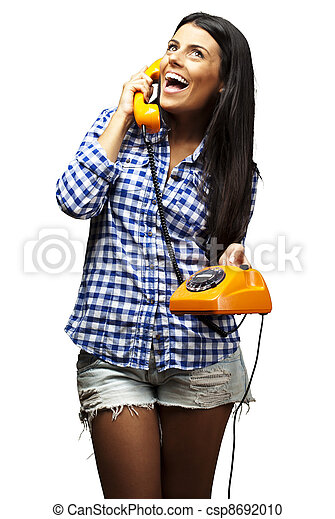 portrait of young woman talking on vintage telephone over white - csp8692010