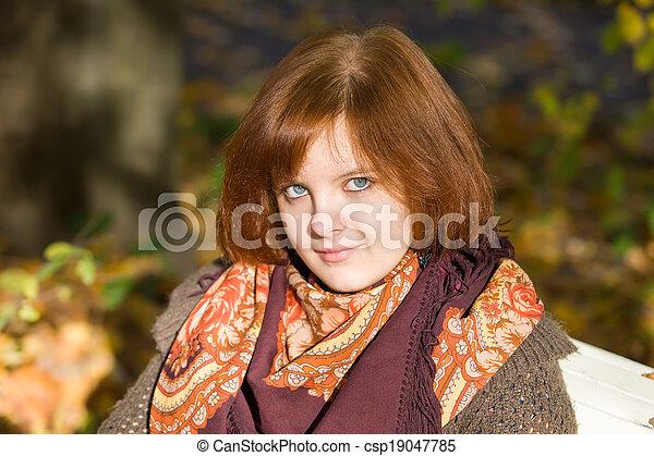portrait on autumn bench - csp19047785