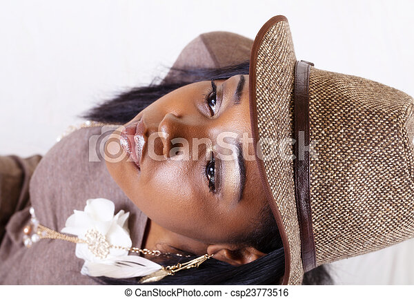 Portrait Young African American Woman With Hat - csp23773516