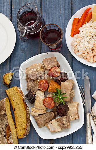 portuguese food on blue wooden background - csp29925255