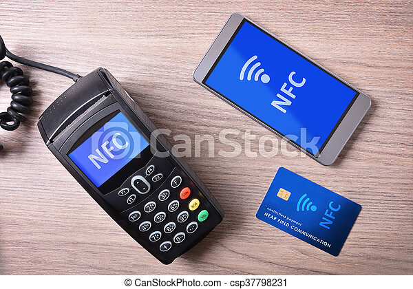 POS card and mobile on wood table nfc transmision system - csp37798231
