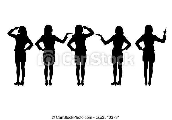Siluetas de mujeres de negocios de pie - csp35403731
