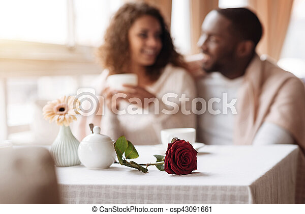 Positive African American couple having the date in the cafe - csp43091661
