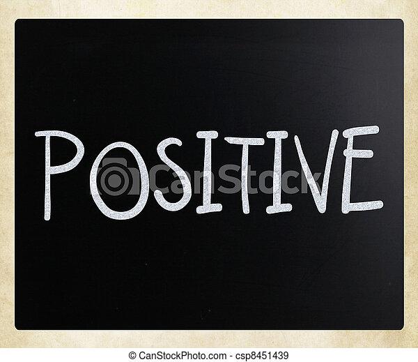"""Positive"" handwritten with white chalk on a blackboard - csp8451439"