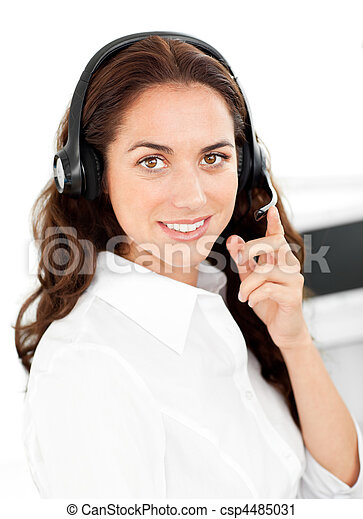Positive woman with headset working in a call center - csp4485031