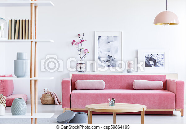 Fine Posters And Flowers Above Pink Sofa In Pastel Living Room Interior With Wooden Table Real Photo Interior Design Ideas Gentotthenellocom