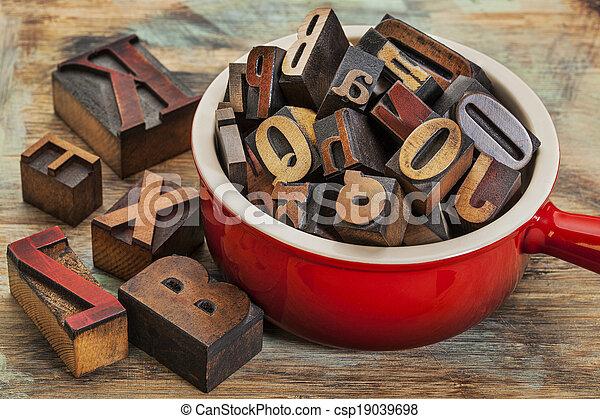pot of letterpress wood type - csp19039698