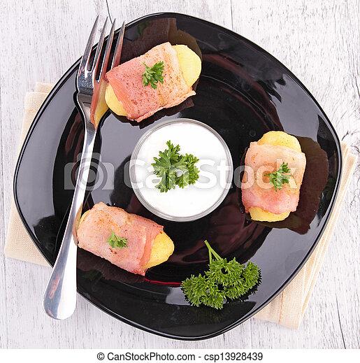 potato wrapped in bacon - csp13928439