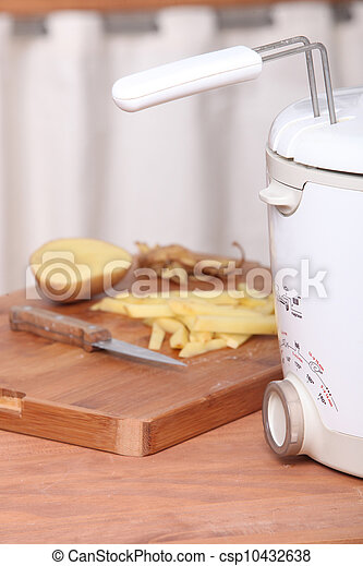 Potatoes and electric fryer - csp10432638