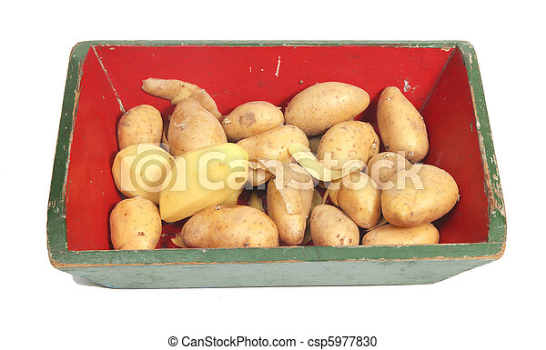 Potatoes peeled and unpeeled in crate - csp5977830