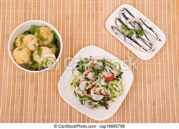 potatoes, salad and salty fish - csp16665798