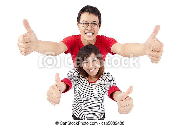 pouce, couple, haut, jeune, célébrer, excité - csp5082488