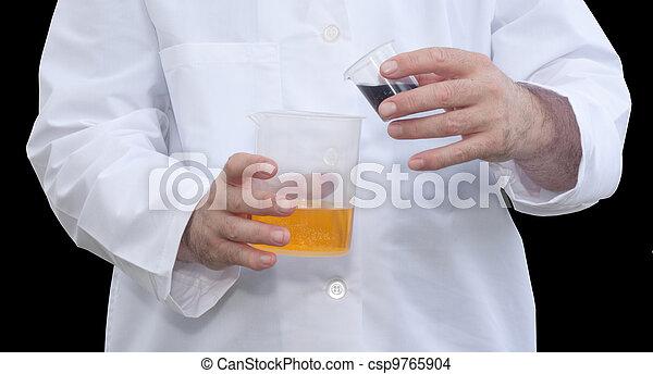 Pouring Liquid Into Beaker - csp9765904