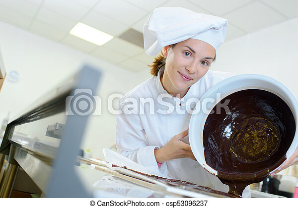 pouring melted chocolate - csp53096237