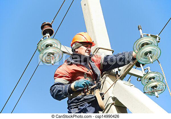 power electrician lineman at work on pole - csp14990426