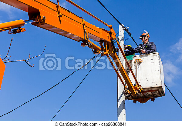 Power line team at work on a pole - csp26308841