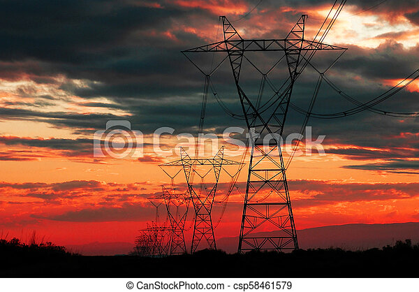 Power Lines at Sunset or Sunrise for Communication and Electricity - csp58461579