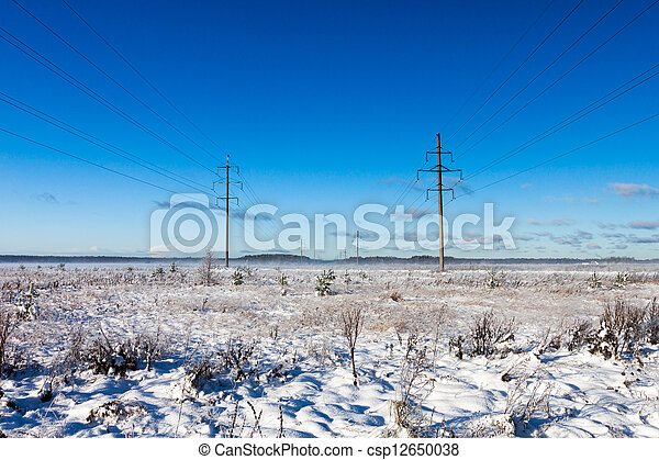 Power lines in winter snow field - csp12650038