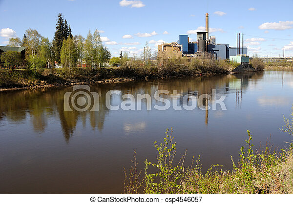Power Plant Along a River in Summer - csp4546057