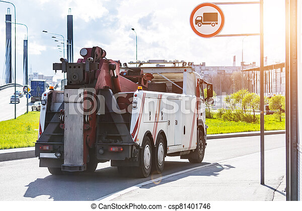 Powerful big rig semi truck tractor tows driving on city highway. - csp81401746