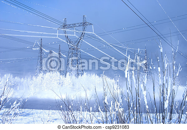 Powerful line of electricity costing in an environment of snowdrifts on a background of the blue sky - csp9231083