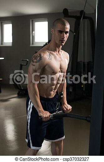 Powerful Muscular Man Exercising Triceps - csp37032327