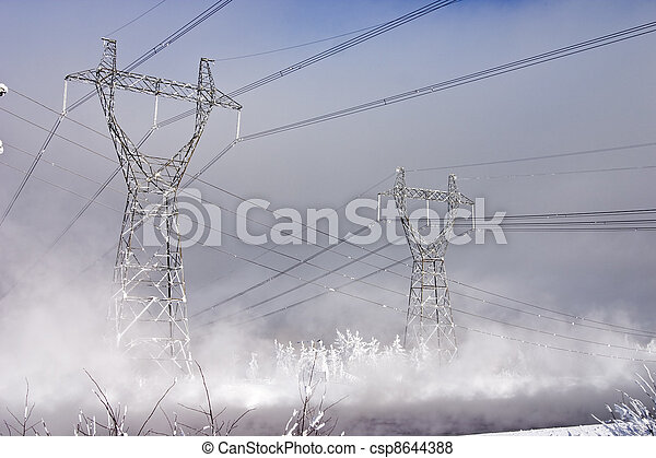 Powerful power station costing in an environment of snowdrifts on a background of the blue sky - csp8644388